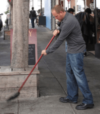 person sweeping